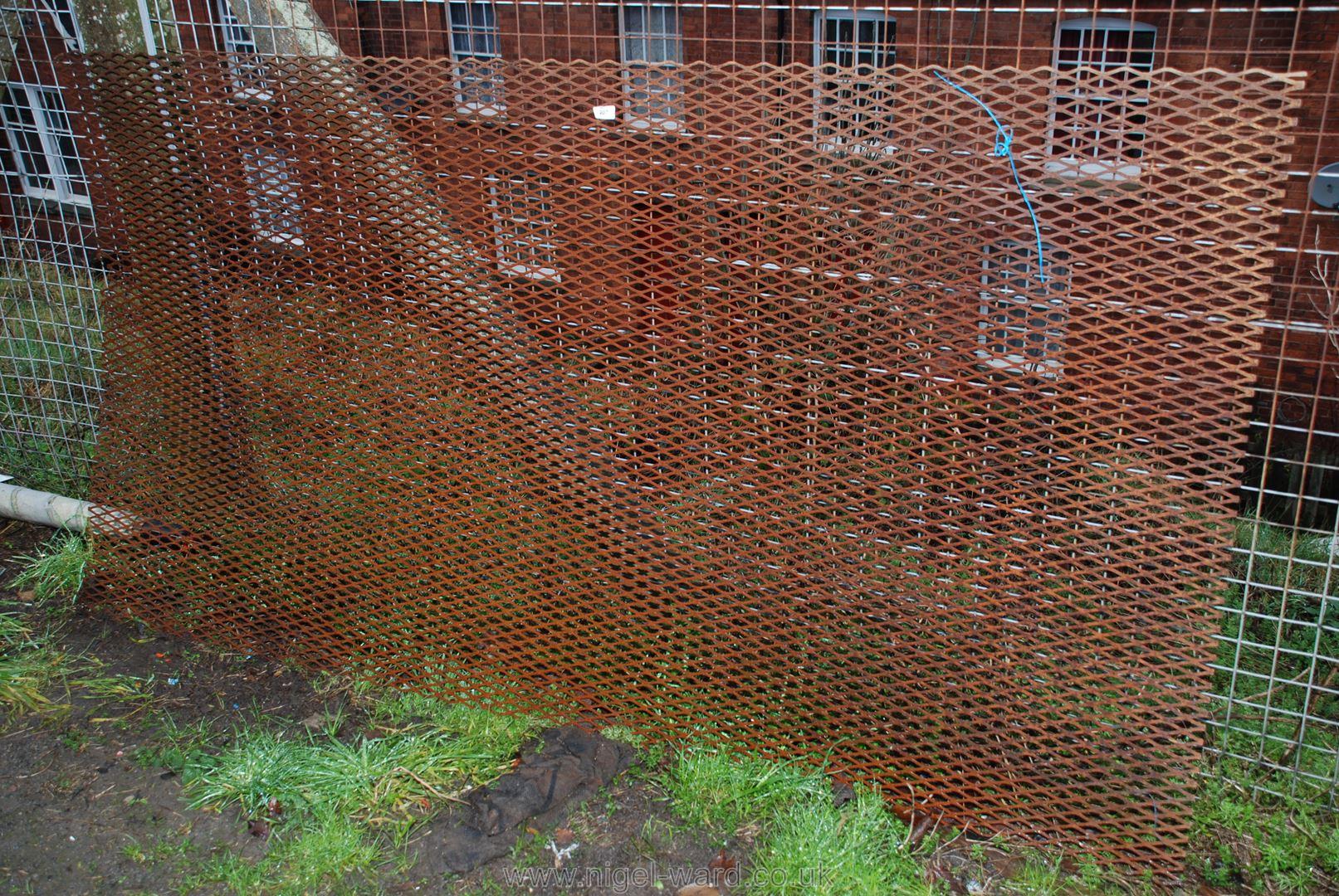 """A sheet of steel mesh, 47"""" x 90""""."""