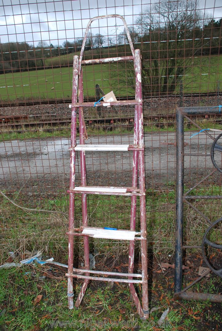 A set of metal step ladders converting to a ladder