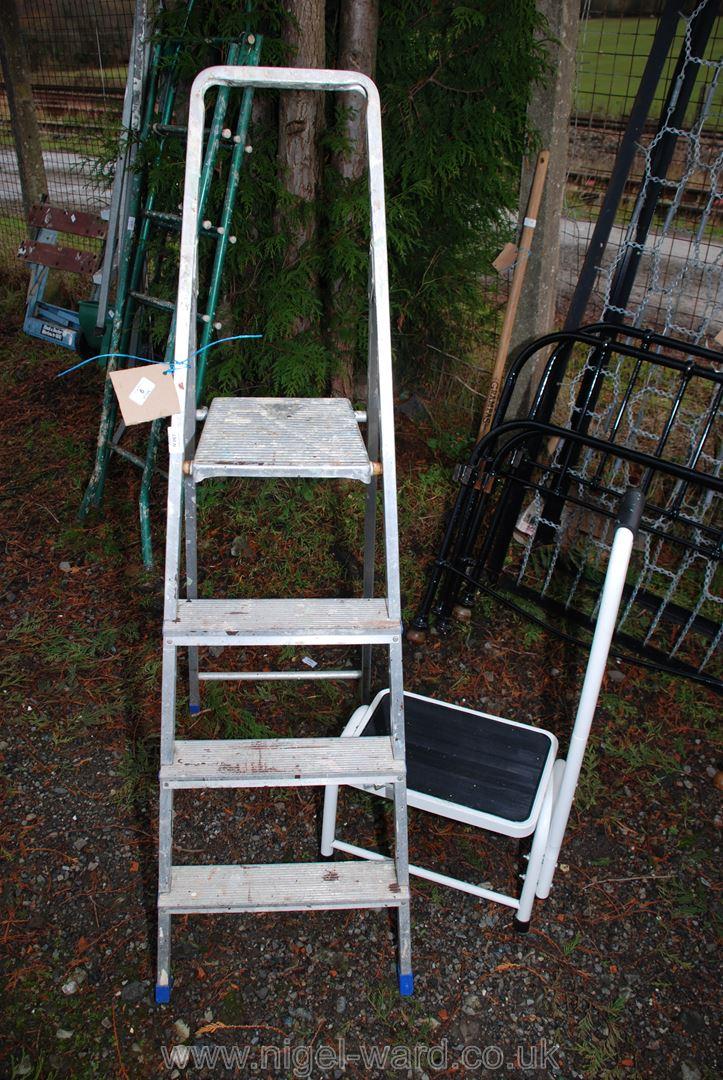 A three rung step ladder and a step stool.