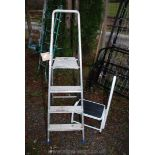 A three rung step ladder and a step stool.