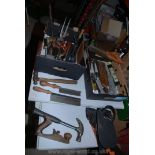Two boxes of various tools, saws, chisels, pliers, etc.