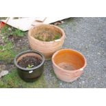 Three garden planters, largest 15'' high x 19'' diameter, one a/f.