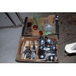 A box of various glass vases and a box of cutlery and stainless steel ware.