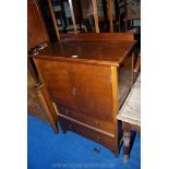 """An Oak two-door tallboy comprising a cupboard with two drawers below, 31"""" x 17"""" x 46"""" high."""