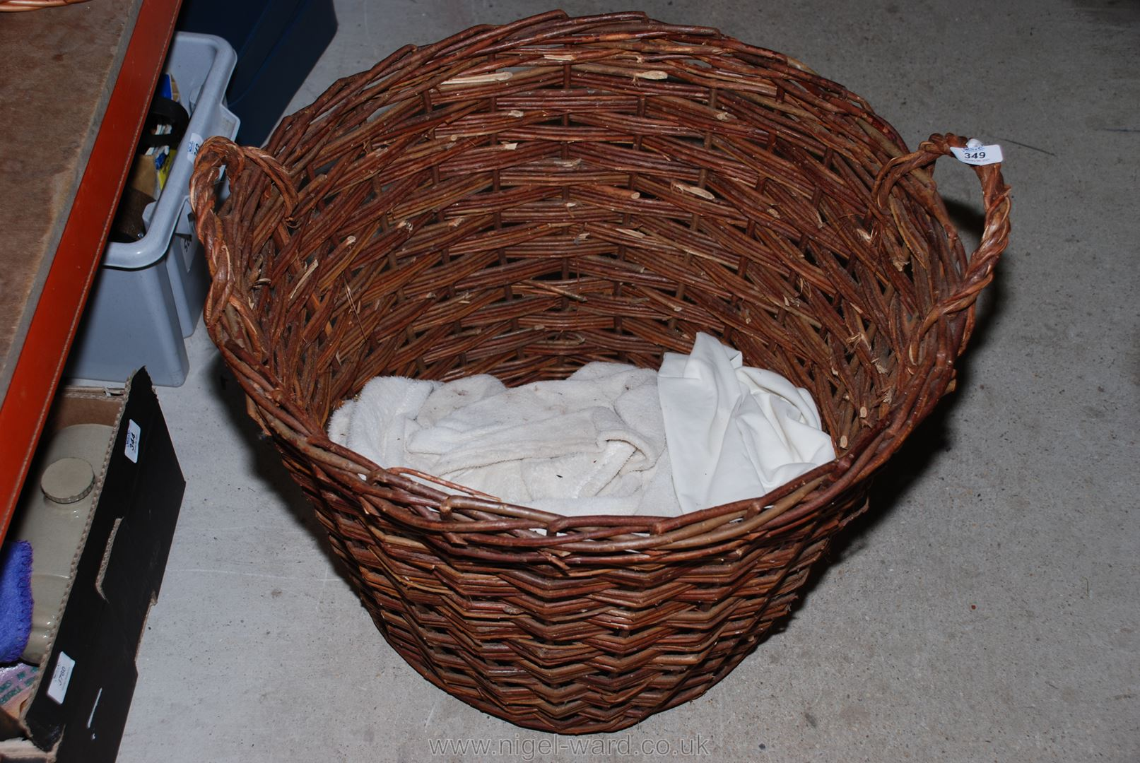 "A large wicker log basket apx 20"" diameter x 19"" high."