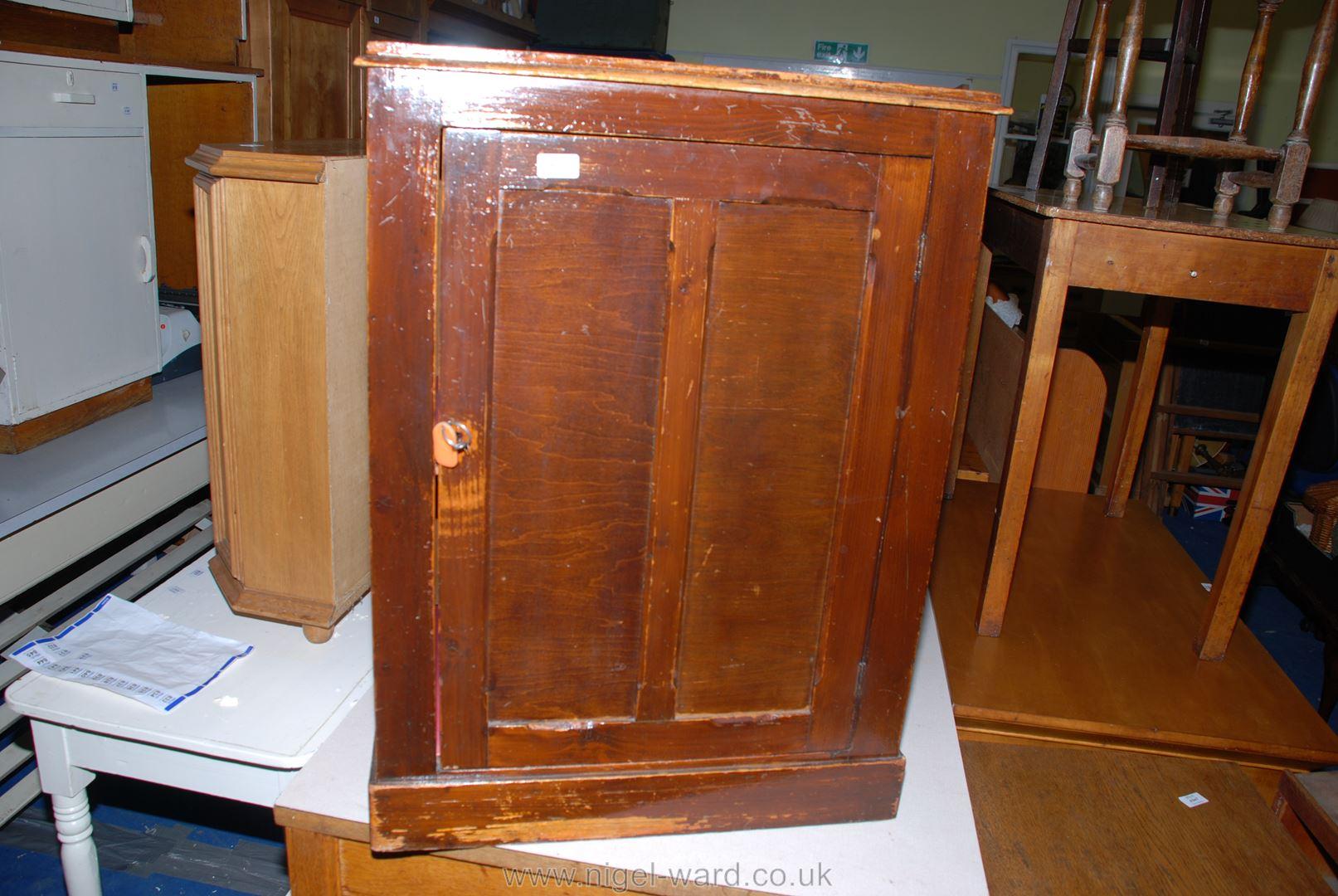 "A single door, single-shelf cupboard with key, 25"" x 17"" x 33 1/2"" high."