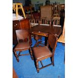 """An Oak draw-leaf dining table 42"""" x 30"""" plus extensions and two chairs with drop-in seats and"""