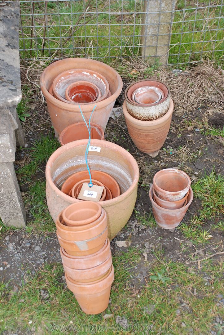 Collection of various sized terracotta flower pots, 30 approximately.