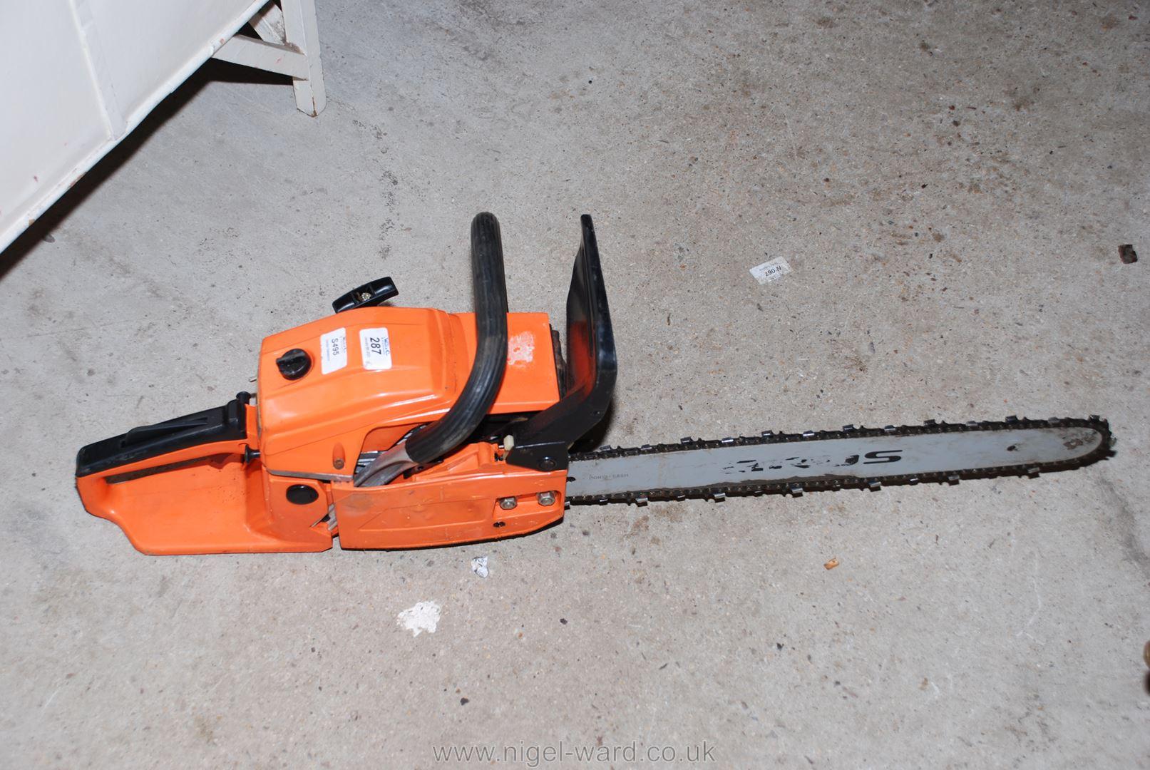 A petrol chain-saw.