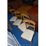 """A six-plank Teak effect kitchen table 29 1/2"""" x 53"""" x 30"""" high and with four matching chairs,"""