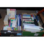 Two boxes of books, one box children's and one box mixed books.
