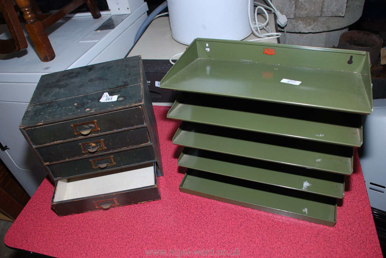 Metal wall hanging Veteran Series filing shelf and a wooden four-drawer stationery box.