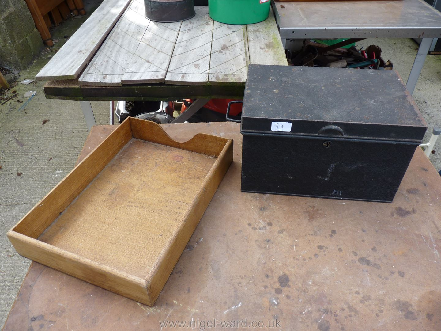 A metal deeds box and wooden stationary tray.