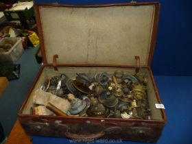 A leather suitcase and a good quantity of oil lamp components, burners, wicks etc.