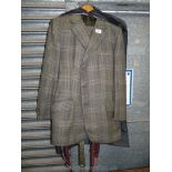 A gents tweed made to measure suit consisting of a button up jacket and trousers with braces,
