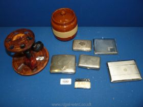 A wooden pipe rack, two pipes, tobacco jar and a quantity of white metal and plated cigarette cases.