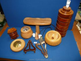 A quantity of treen including a lamp stand, pot pourri pots, wooden picture holders etc.