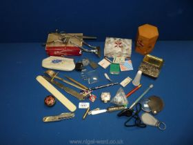 A small box of miscellaneous items including a fruit knife, letter openers,