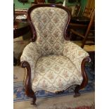 A Victorian button back Mahogany show frame Armchair having scroll feet and arms, cream ground,