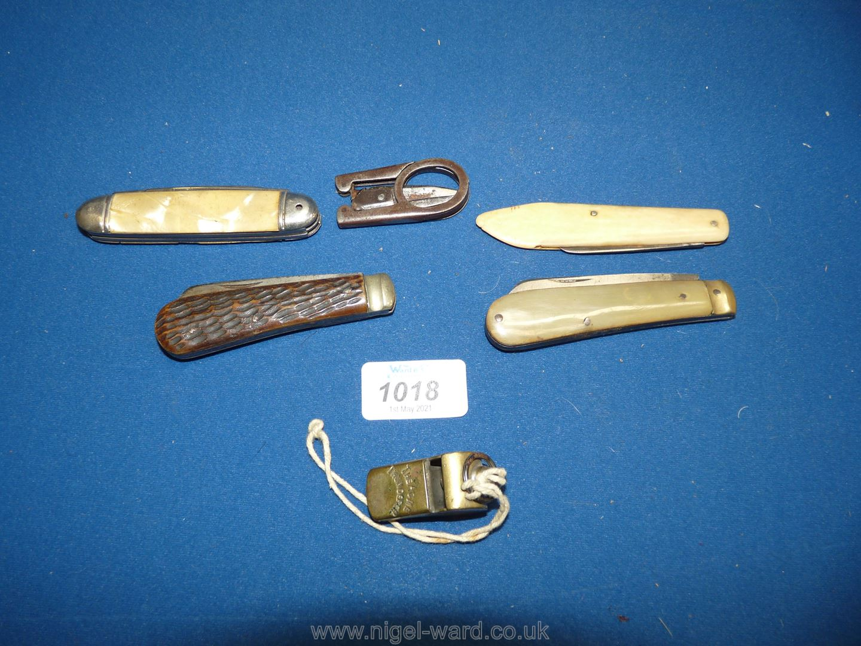 Two Lamb Foot penknives, a bone handled penknife, Thunderer whistle,