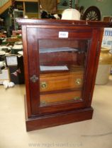 An Oak glass fronted Smokers Cabinet with shelf fitted for pipes and two drawers with brass handles,