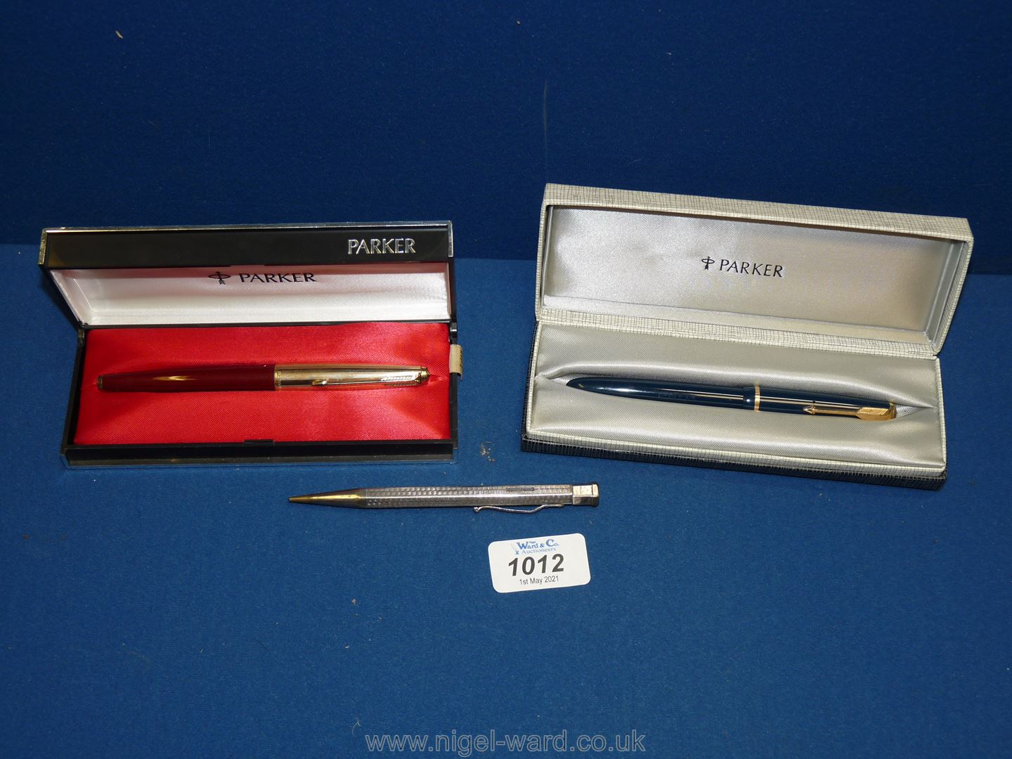 Two boxed Parker Pens and a Silver propelling Pencil, maker JM&C,