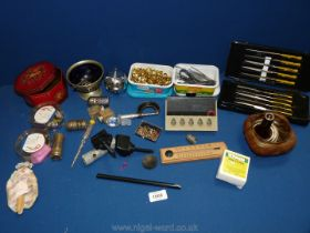 A box of miscellanea to include tweezers and pins, thermometer, pen stand,