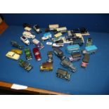 A collection of 30 model vehicles, mainly trucks and vans including Corgi, Matchbox,