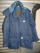 A navy blue Helly Hansen double lined Raincoat with hood,