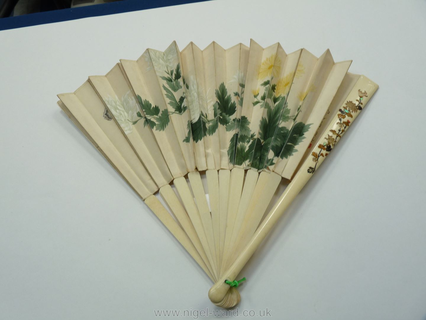 A Japanese painted silk Fan with signatures and red seal marks, the sticks inlaid with coral, - Image 2 of 2