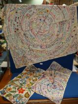 Three heavily embroidered cloths: two with dates, names and places hand embroidered.
