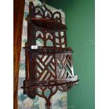 "A Mahogany Gothic style fretwork hanging corner shelves, 38"" tall (slightly cracked at bottom)."