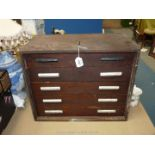 """A carpenter's Cabinet having five drawers, with metal handles, 15"""" tall x 18 1/2"""" x 10""""."""