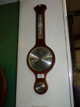 A Mahogany framed Aneroid Banjo Barometer/Thermometer/ Hydrometer by ''Moco, England'',