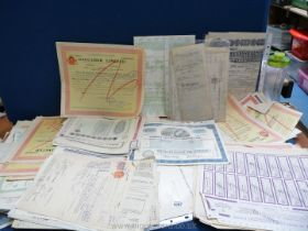 A quantity of old share certificates, conveyance documents etc.