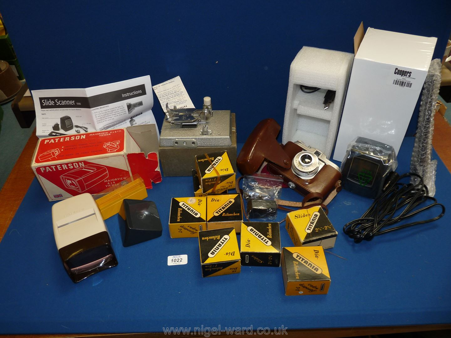 A quantity of miscellanea including a Bell and Howell 604 film slicer, an Agfa Isola 1 film camera,