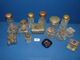 A box of glass ink wells, dressing table sets.