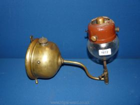A brass wall hanging pressurised Oil Lamp possibly tilly.