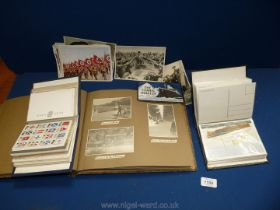 Two albums of reproduction Titanic postcards,