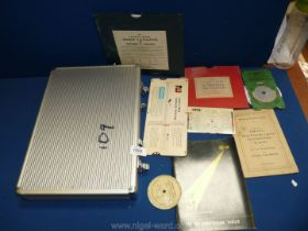 An aluminium case of Engineering and mathematical Instruments including window type circular