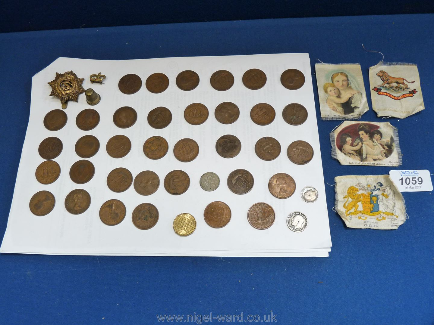An Order of the Garter badge together with a quantity of half pennies, silver 3d piece, 3p bit,