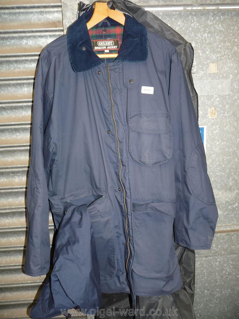 A gents dark navy waterproof 'Gelert Brecon' 3/4 length jacket with a tartan woolen lining, size L.