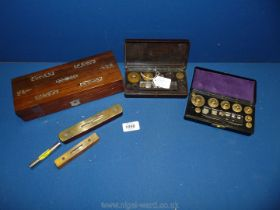 A Rosewood box with Mother of Pearl decoration and contents including spirit levels and laboratory