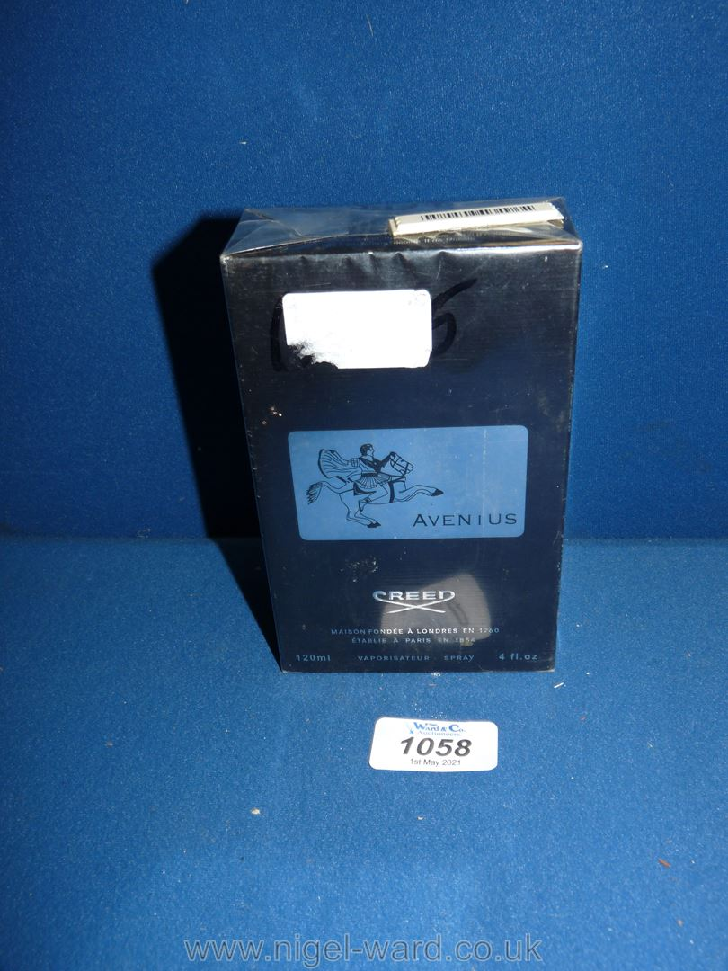 A bottle of 'Creed' aftershave, unopened.