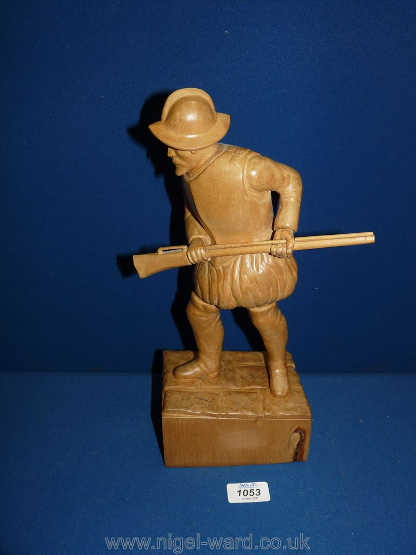 """A carved lime wood figure of a Conquistador, 13 1/2"""" high."""