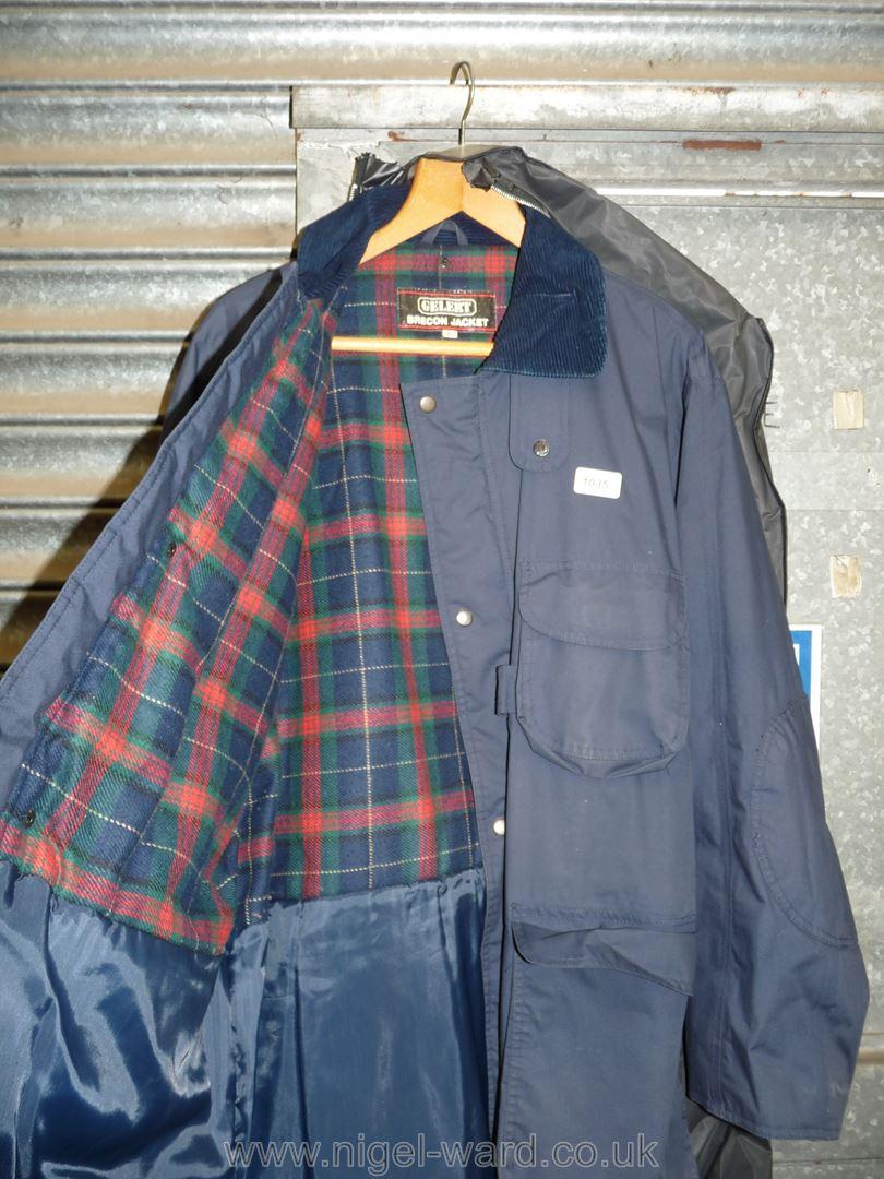 A gents dark navy waterproof 'Gelert Brecon' 3/4 length jacket with a tartan woolen lining, size L. - Image 2 of 2
