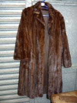A Fur coat with three quarter length sleeves, size M/L.