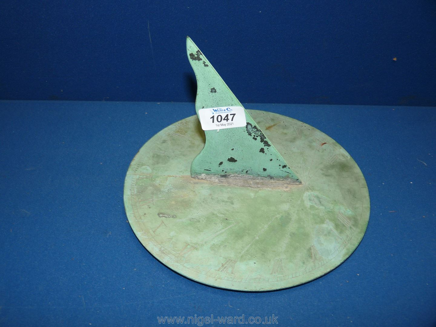 An antique bronze Sundial with weathered green patina,
