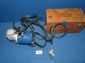 """A Schrader Electric air pump, model 202 - DCI 12 v in wooden box, 9"""" x 5""""."""