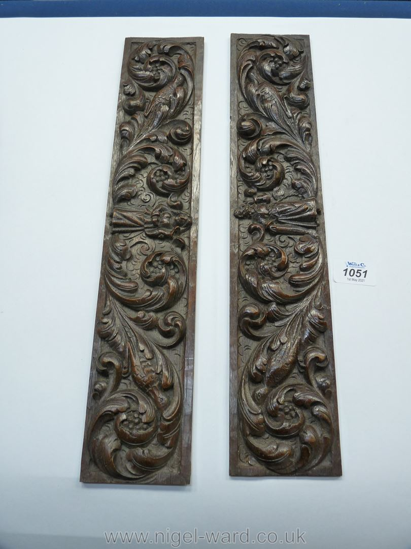 A pair of oak frieze Panels, each carved with a central gowned figure among foliage and birds,